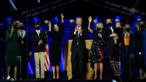 President-elect Joe Biden, center with his wife Jill Biden , right, and members of their family on stage waving to supporters, Saturday, Nov. 7, 2020, in Wilmington, Del. (AP Photo/Andrew Harnik, Pool)
